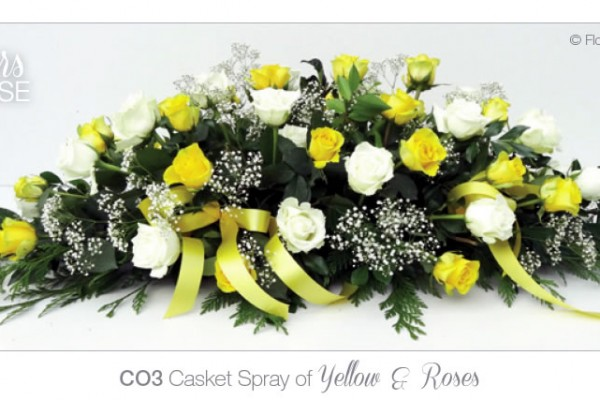 Casket spray of yellow and white roses