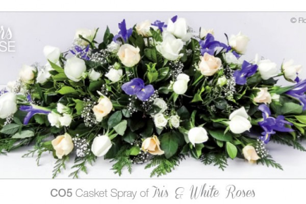 Casket spray of iris and white roses