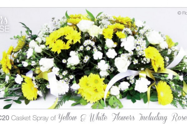 Casket spray yellow and white including roses