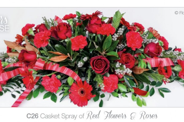 casket spray red flowers and roses