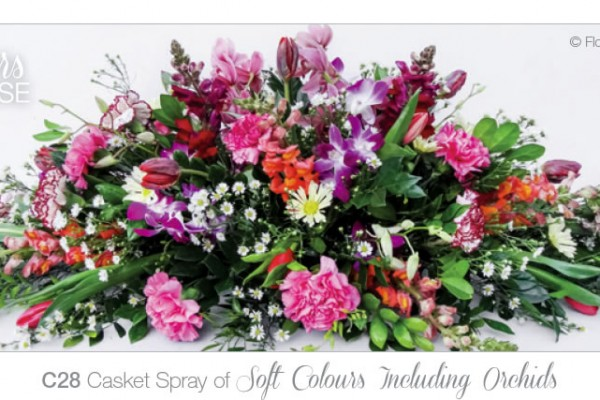 casket spray soft colours and orchids