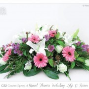 casket spray mixed lilies roses