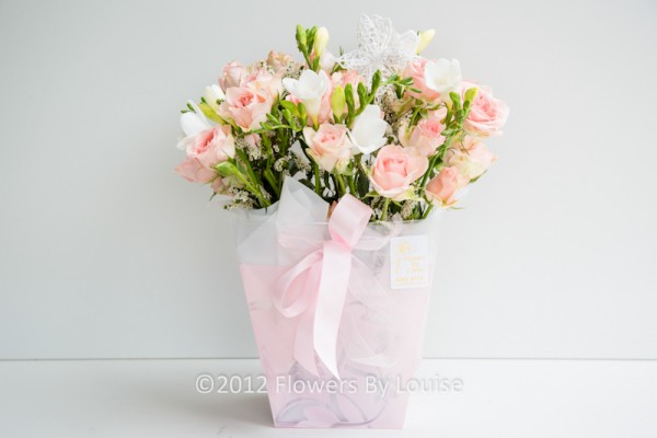 Bag of Soft Roses and Freesia
