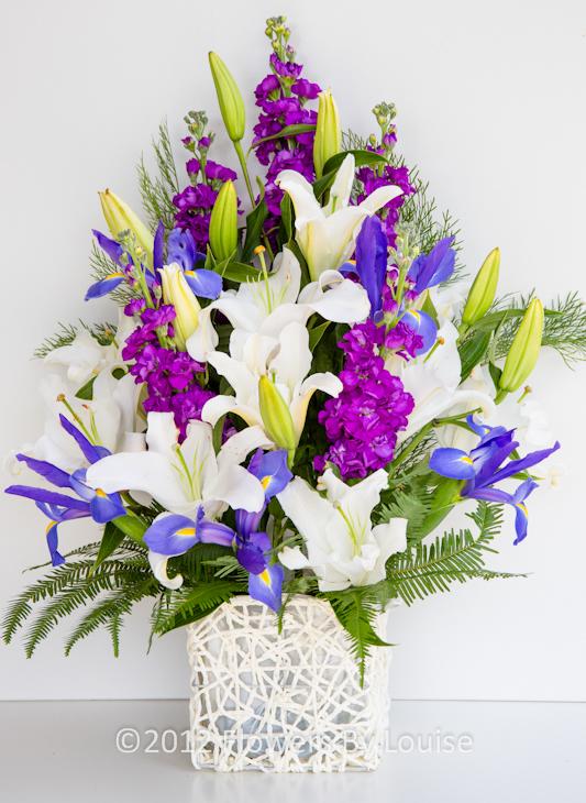 Woven Basket Oriental Lily + Blue Iris + Stocks