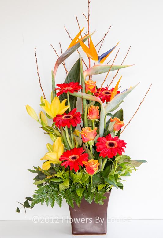 Modern Arrangement Bird of Paradise + Lily + Gerbera + Roses