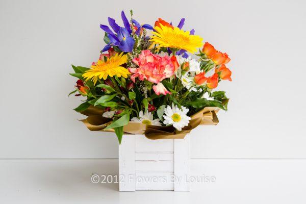 Wooden Box of Bright Spring Flowers Iris + Gerberas + Spray Roses + Chrysanthemums + Carnations